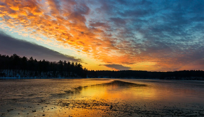 Sunset with ice on Walden Pond, MA, 2013 © Tom Grill