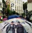 Color photograph © Robert Herman, umbrellas in crowded street