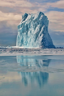 Color photo of iceberg and reflection, Arctic Bay © Michelle Valberg