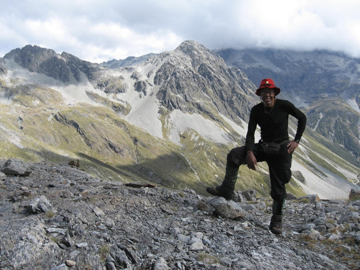 Photo of explorer and Author J. Robert Harris standing in mountain landscape
