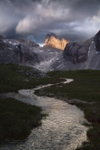 "Color photograph, ""Where the Streams Have No Name"" by Erin Babnik: Storm clouds over a high plain of the Dolomites (2016)"